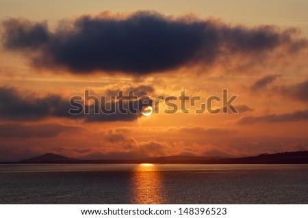 Sunset on the Irish coast - stock photo