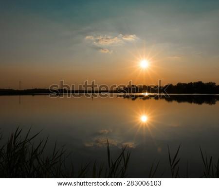 Sunset on the lake  - stock photo