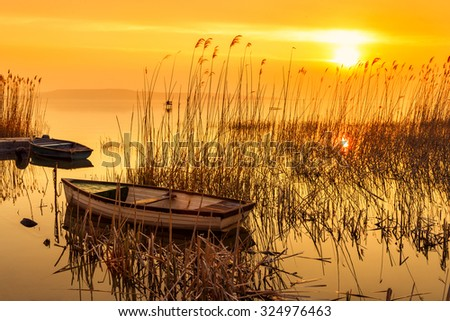 Sunset on the lake Balaton with a boat in Hungary - stock photo