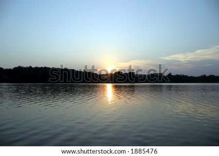 Sunset on the Lake - symmetry - Rock Creek Lake, Iowa - stock photo