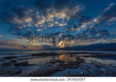 sunset on the mountain lake Issyk-Kul, Kyrgyzstan - stock photo