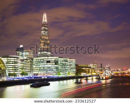 Sunset on the new London skyline with Tower Bridge and the new The Shard skyscraper. Long exposure. Shot in 2013  - stock photo