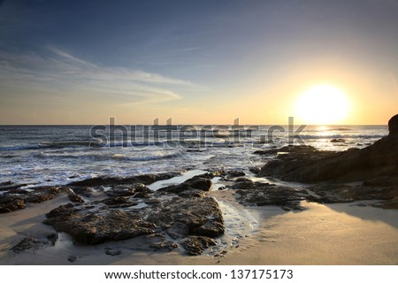 Sunset on the Pacific Ocean Beach of Costa Rica - stock photo