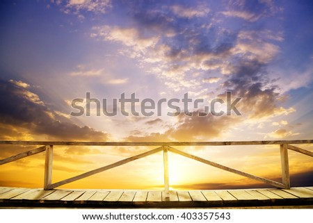 Sunset on the sea. A kind from a wooden porch - stock photo