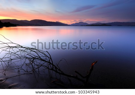 Sunset on the shores of Loch Lomond - stock photo