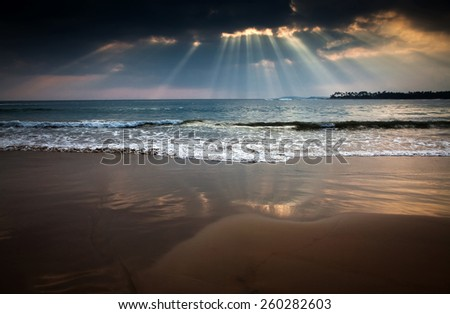 Sunset on tropical beach - stock photo