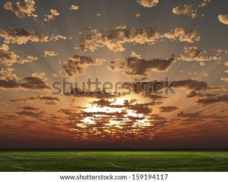 Sunset or sunrise over grass landscape - stock photo