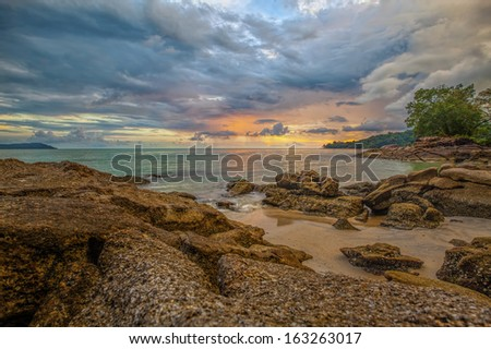 Sunset over a beach on Langkawi island - stock photo