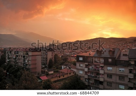 Sunset over a city - stock photo
