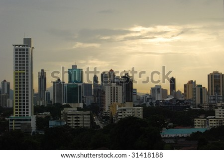 sunset over a city in central america - stock photo