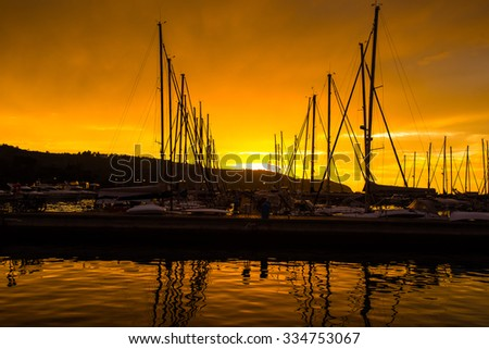 sunset over a marina  - stock photo