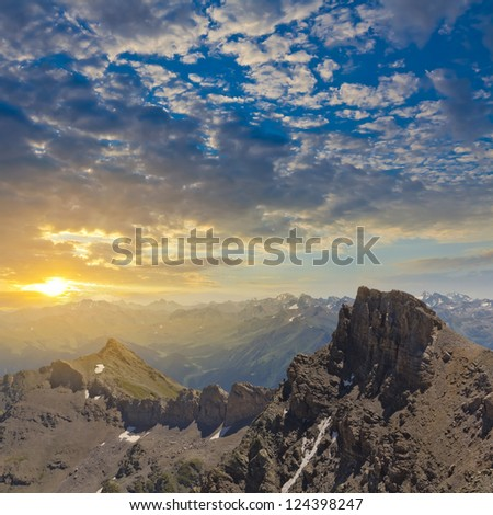 sunset over a mountain valley - stock photo