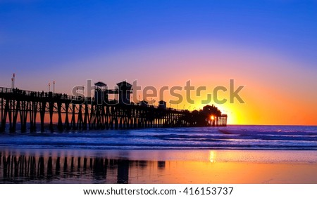 Sunset over a pier in California  - stock photo