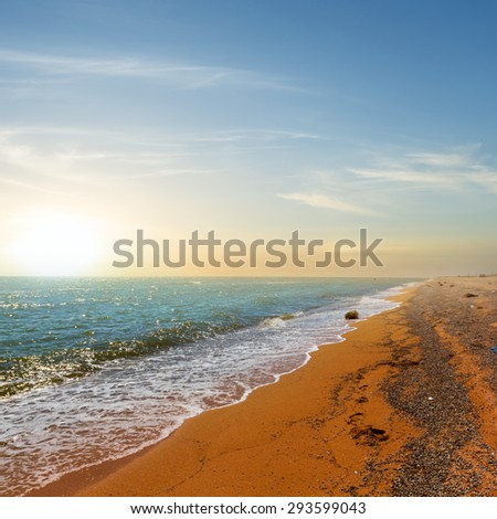 sunset over a sea coast - stock photo