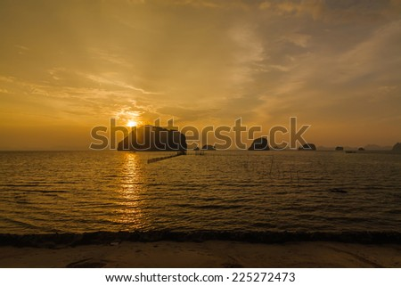 Sunset over a tropical island in the South thailand sea - stock photo