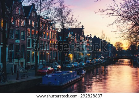 Sunset over Amsterdam, Netherlands canals and bridges. Night view of Keizersgracht and famous touristic place - stock photo