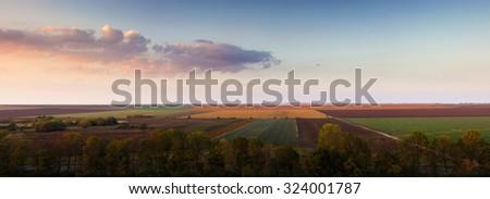 Sunset over autumn field - stock photo