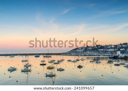 Sunset over Brixham marina - stock photo