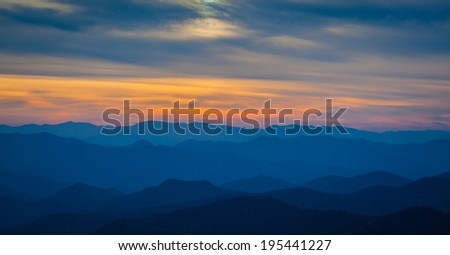 Sunset over Cowee point on the Blue Ridge Parkway in North Carolina - stock photo