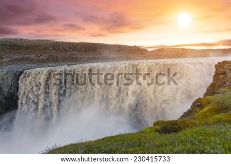 Sunset over, Dettifoss the most powerful waterfall on Iceland and in the whole Europe. It is located in Jokulsargljufur National Park the northeasten Iceland  - stock photo