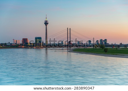sunset over Dusseldorf at the rhine river in germany - stock photo