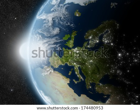 Sunset over Europe region on planet Earth viewed from space with Sun and stars in the background. Elements of this image furnished by NASA. - stock photo