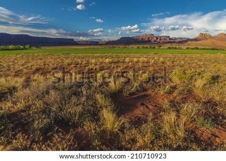 Sunset over Fisher Mesa along the road US 128 near Moab Utah   - stock photo