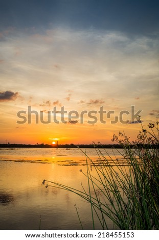 Sunset over Florida wetlands - stock photo
