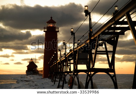 Sunset over Grand Haven Lighthouse, Grand Haven, Michigan, USA - stock photo