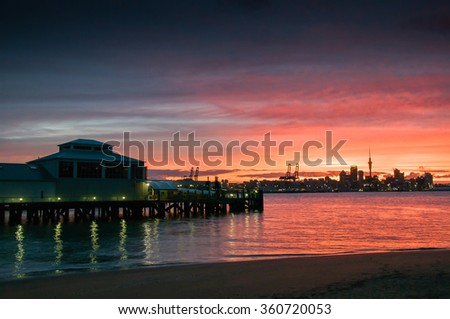 Sunset over Harbor at Auckland  - stock photo