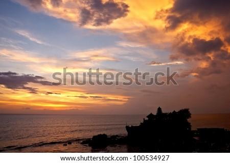 sunset over hindu temple Tanah Lot, Bali - stock photo