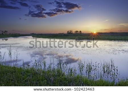 Sunset over Illinois Sunset over an open field in Illinois. - stock photo