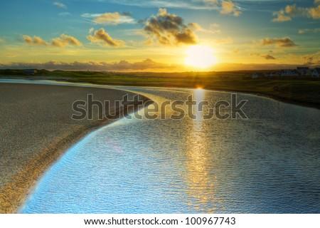 Sunset over Irish coast in Lahinch - stock photo