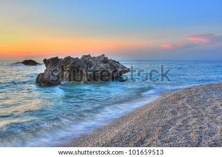 Sunset over Kathisma beach (Lefkada island-Greece). The most impressive beaches from Lefkada are Porto Katsiki, Kathisma and Egremnoi. - stock photo