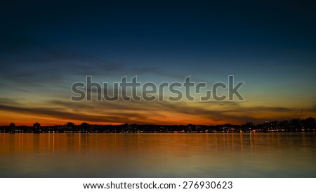 Sunset over Kempenfelt Bay and the City of Barrie Ontario skyline. - stock photo