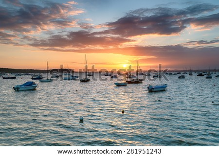 Sunset over Poole Harbour in Dorset, looking out to Brownsea Island from Sandbanks - stock photo