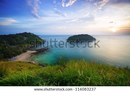 Sunset over Promthep cape and Yanui beach. Phuket, Thailand. - stock photo