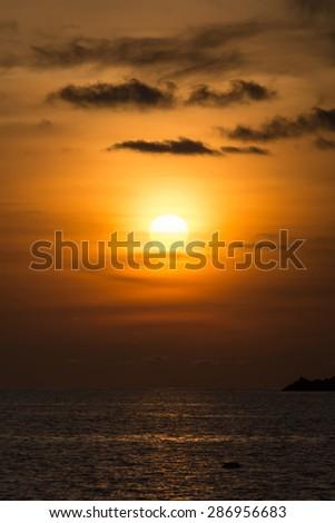 Sunset over sea at Ya Nui beach - stock photo