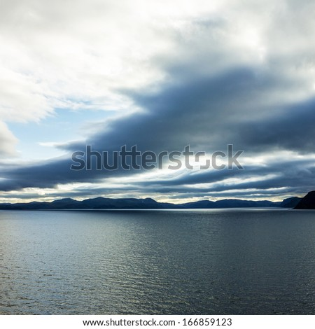Sunset over sea, Norway mountain seascape - stock photo