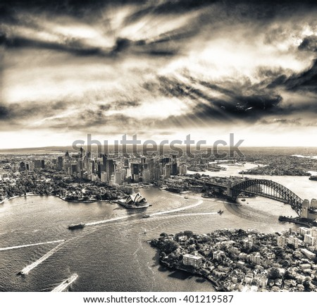 Sunset over Sydney Harbour, helicopter view. - stock photo