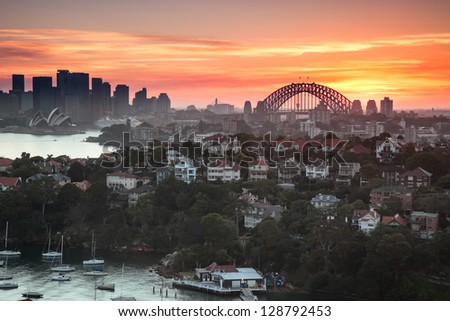 Sunset over Sydney harbour, taken from a unique position which is not available to anyone - stock photo