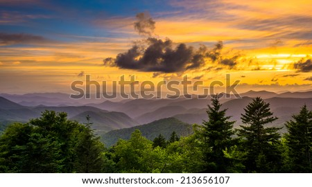 Sunset over the Appalachian Mountains from Caney Fork Overlook on the Blue Ridge Parkway in North Carolina. - stock photo