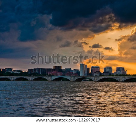 Sunset over the Arlington Memorial Bridge and Rosslyn Skyline on the Potomac River, seen from Washington, DC - stock photo