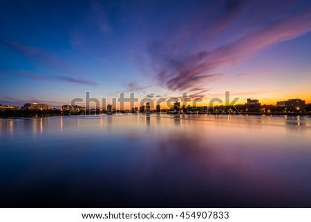 Sunset over the Charles River, seen from the Massachusetts Avenue Bridge, in Cambridge, Massachusetts. - stock photo