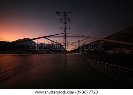Sunset over the ferry - stock photo