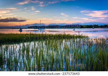 Sunset over the Folly River, in Folly Beach, South Carolina. - stock photo
