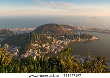 Sunset over the Lagoa in Rio de Janeiro, Brazil. View from Corcovado is spectacular and shows Rio's amazing, wondrous topography. (Corcovado is Christ the Redeemer mountain). - stock photo