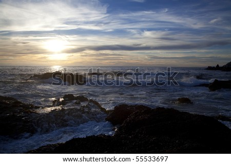 Sunset over the ocean in Point Lobos State Natural Reserve in California - stock photo