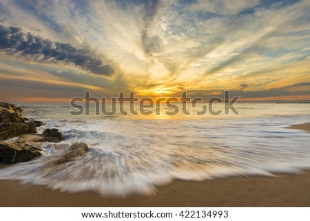 Sunset Over the Ocean on a Beautiful Summer Evening. - stock photo
