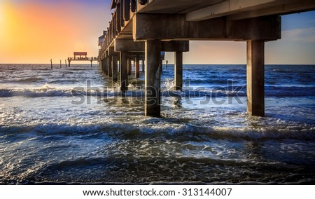 Sunset over the outgoing tide of Clearwater Beach, Florida.  - stock photo